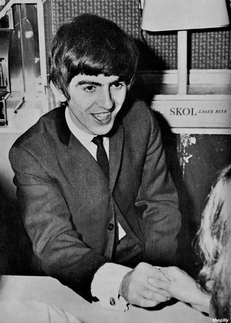 George shakes hands with fans at a meet and greet after a special fanclub performance at the Wimbledon Palais on 14 December 1963. Scan from Beatles Book Monthly No. 7.