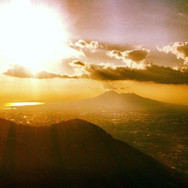 That's Mt. Vesuvius over yonder Ecco il Vesuvio... #pompeii #vesuvius #vesuvio #faunopompei #travel #italy #napoli #volcano #night #mountvesuvius #pompei #mountain #excursions #travel #italy #naples #bay