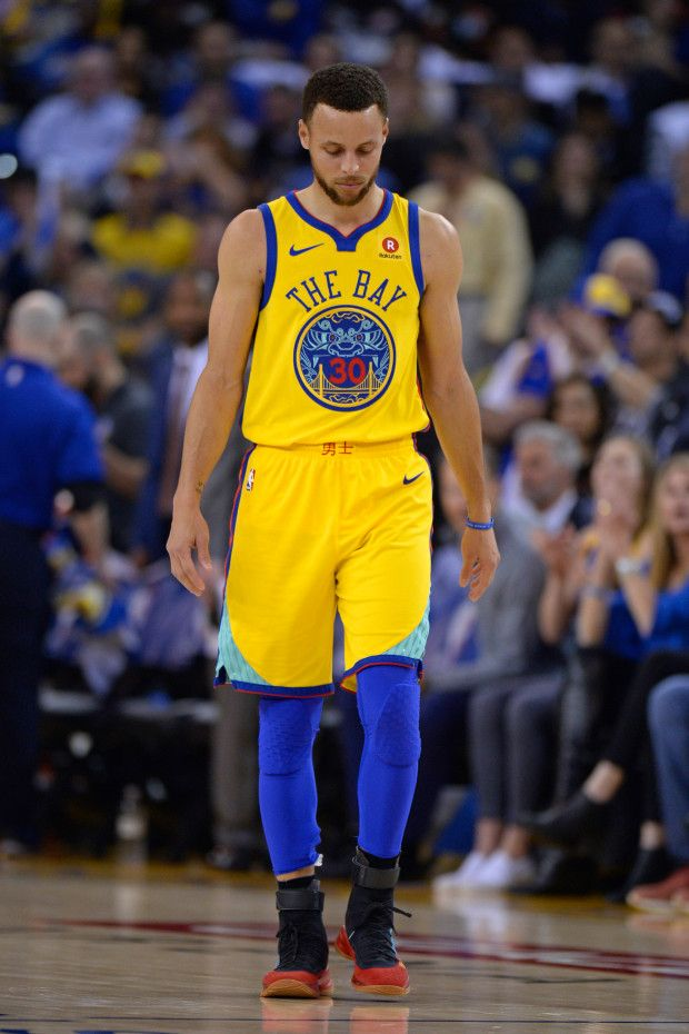 9dc849df058 Golden State Warriors' Stephen Curry (30) walks back to take his free-throws  after injuring his right ankle while playing the San Antonio Spurs during  the ...
