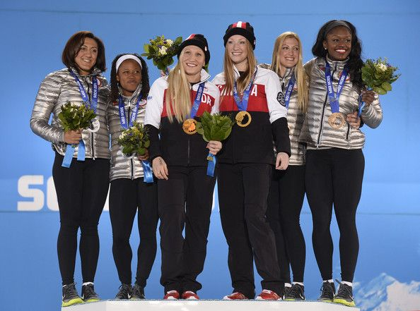 (L-R) Silver medalists Elana Meyers and Lauryn Williams of the United States team 1, gold medalists Kaillie Humphries and Heather Moyse of C...