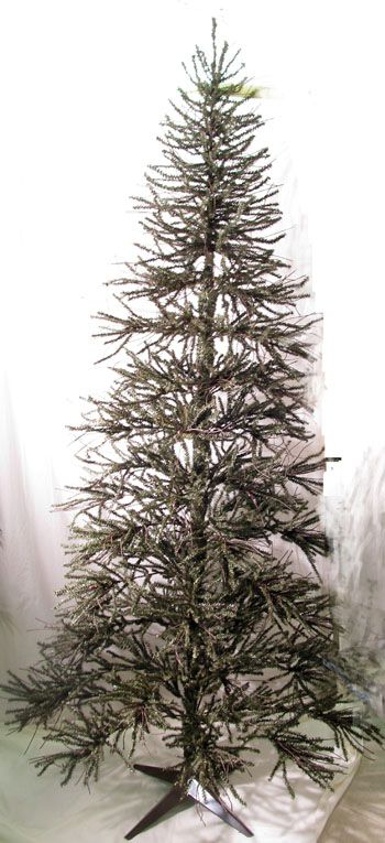 Rustic, minimal german twig tree with metal stand.  Three sections that slide together.  Height 7 ft. Width 3 ft  Note 4 ft tree sold below.