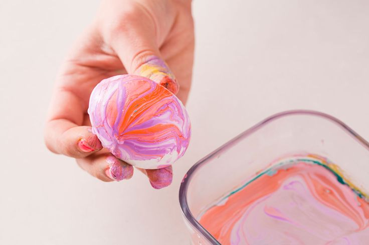 Use nail polish to make pretty marbled eggs for Easter.