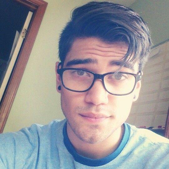 Rajiv Dhall with glasses..