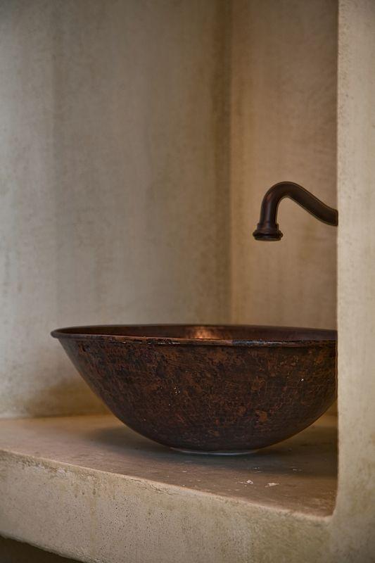 Architecture & Interior design by DESIGN LAB VI, traditional White House in Othos Karpathos, Greece. #designlabvi, #karpathos, bronze bathroom sink,  polish concrete finish  www.designlabvi.com