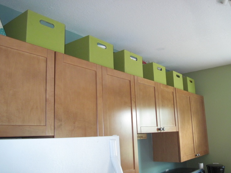 Use the space above kitchen cabinets for extra storage in for Extra storage for small kitchen