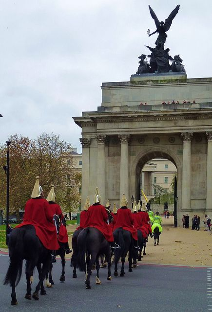 London - Life Guards passing under Wellington Arch. I saw this & later went up into the Arch- good view from there.