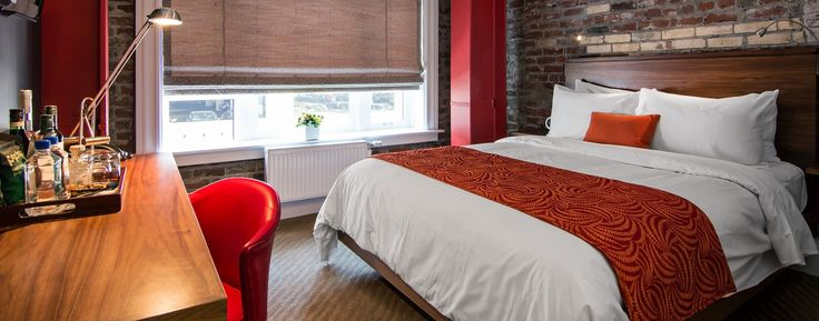 Mystic Hotel San Francisco: Rooms blend original details like exposed brick and bay windows with a clean, minimal style.