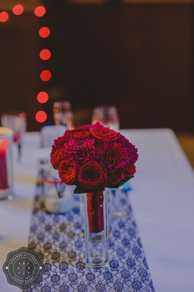 Lovely red wedding bouquet with roses and dahlias and red ribbon. http://johannahietanen.com