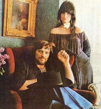 Waylon Jennings and Jessi Colter. she opened for him when we saw him. they did two duets, Suspicious Minds & Deep in the West.
