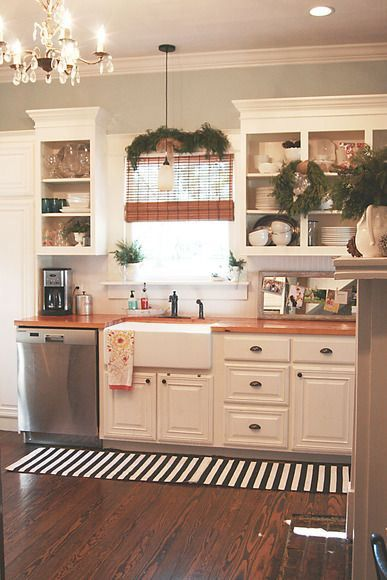 Cabinets are not white // Rustic Wood Kitchen theme with green in window sill