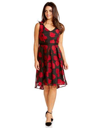 Jacqui e red dress goes