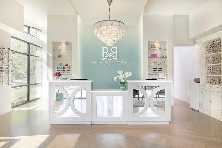 This is my favorite office design but I am afraid it might be too feminine.  I love the color.  I love the clean white displays.  Love the chandelier.