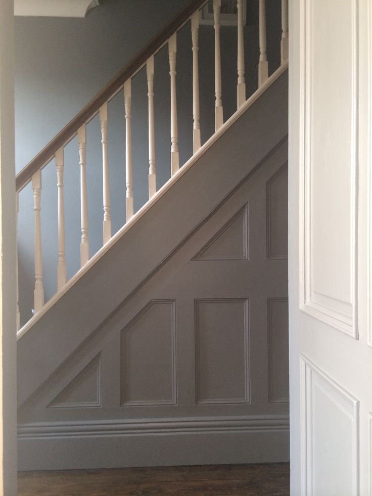 panelling in Farrow & Ball 'plummett'. Stairs in 'all white'