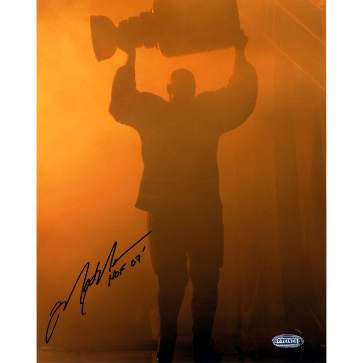 Mark Messier Oilers Retirement Night Entering through Smoke with Stanley Cup w HOF 07 Insc. 8x10 Photo - Mark Messier began his NHL career with the Edmonton Oilers later leading the New York Rangers to the 1994 Stanley Cup championship. Mark Messier is known as one of the games greatest hockey players winning six Stanley Cup Championships and was named captain on two different teams. Mark Messier has hand signed this 8x10 photograph of him walking through the smoke on Feb. 27 2007 as the…