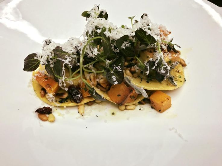 Homemade pumpkin ravioli with butternut squash, pine nuts and onion seeds with pecorino cheese