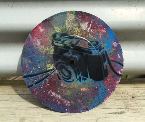 Handmade stencil, spray painted on an upcycled vintage 18cm (7) vinyl record. The record has slight warping due to its age. Price reduced.  One off
