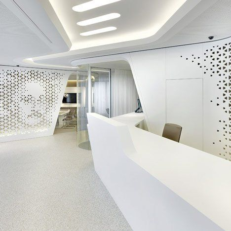 Design cooperativeNAU and DGJ have completed this interior for Swiss bankRaiffeisen in Zurich, featuringcurving walls perforatedto create pictures of faces. The bank is designed as a lounge with the banking terminals concealed within pieces of furniture. The perforations extend from reception to the employee workstations and the courtyard beyond, creating abstracted images of historical residents