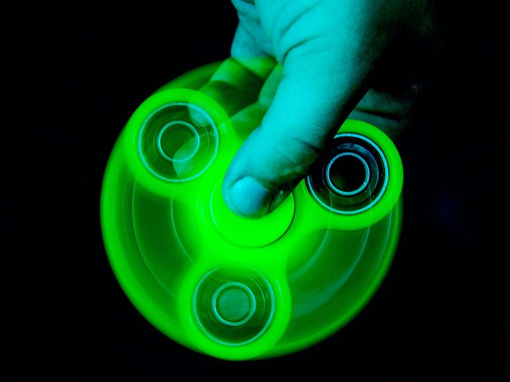 Fidget spinners are everywhere. How long can you make one spin? That depends on the starting speed and the angular acceleration.