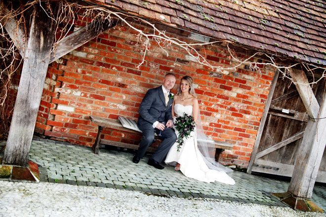 Bride and groom outside at Rivervale Barn - Christmas wedding | www.allabouttheimage.co.uk