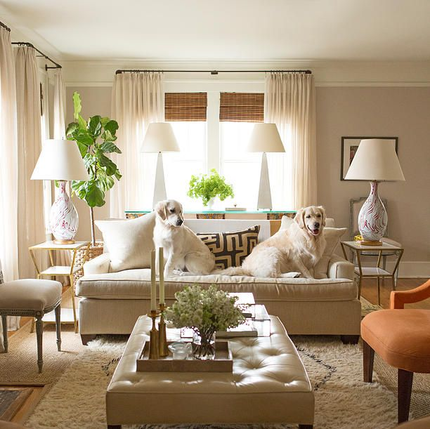 [Never mind how they styled the ottoman--I like how they styled the couch!  I don't like the way they've put the drapery rods up in the crown molding, though.  Too high.]  Styling the Ottoman