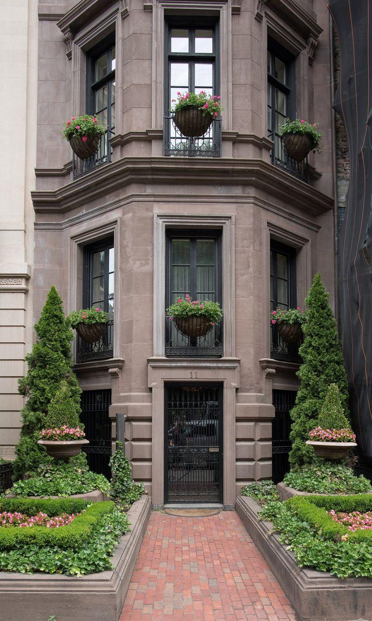 Garden Symmetry On A Beautiful Brownstone Building In
