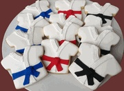 Cookies decorated like the tops of Karate or Tae Kwon Do uniforms are perfect for a Martial Arts party or event. You can even specify what rank belt colors you want (shown here with blue belt, red belt, and black belt cookies) and what flavor cookie you want (sugar cookies, chocolate chip cookies, etc.)