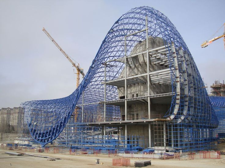The Heydar Aliyev Cultural Center's exterior space frame is completely separate from the rest of the building. It's inefficiencies lie in its lack of integration with the rest of the building becoming little more than an expensive 'dress' for the building.