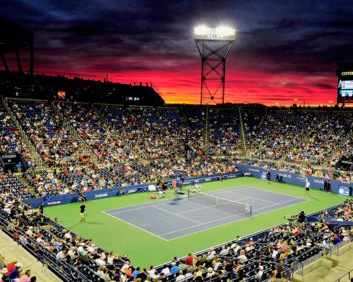 The sun sets over Louis Armstrong Stadium during the third round Men's Singles match between John Isner of the United States and Kyle Edmund of Great Britain on Day Five of the 2016