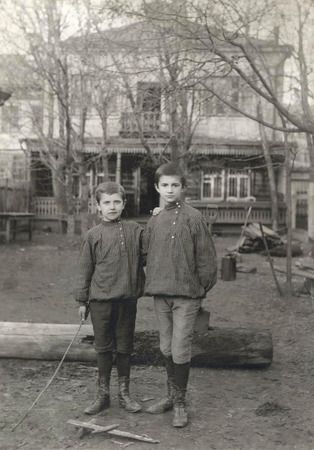 1900-1910 ~ Unknown author. Portrait of 2 boys in Russian national shirts standing outdoors. Moscow House of Photography collection