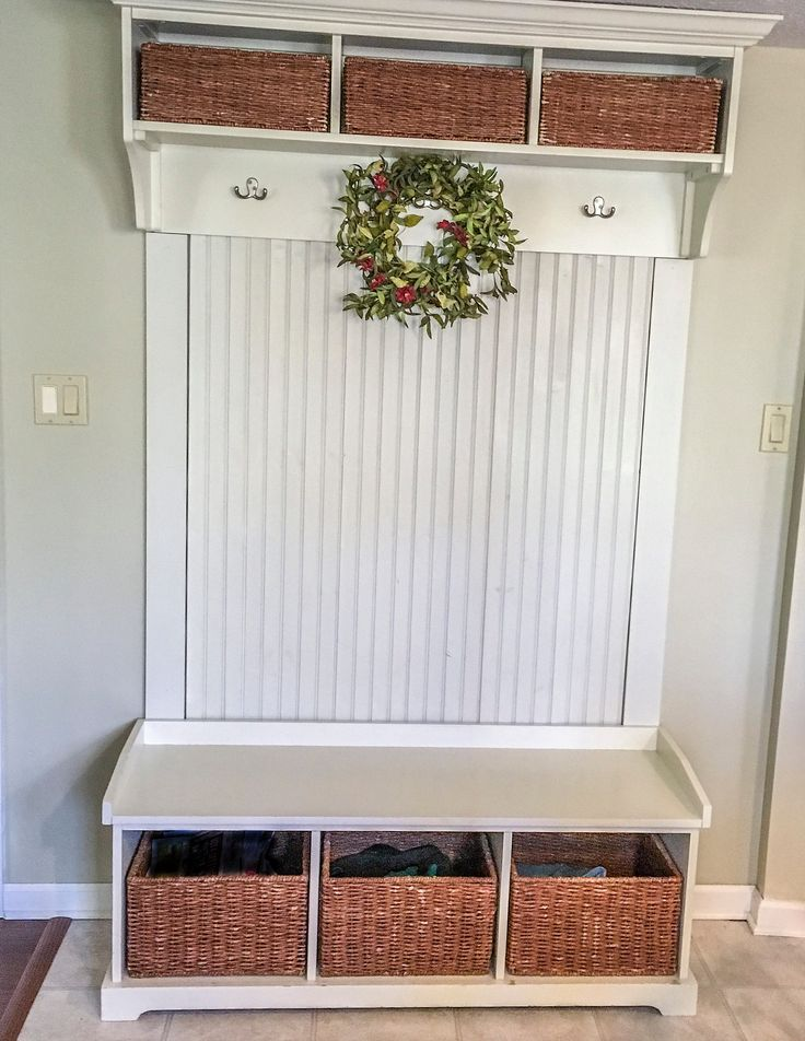 Pottery Barn storage with bead board mounted in between.
