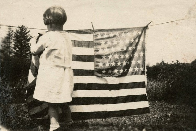 "Hanging ""Old Glory"" Out to Dry    A touching photo from the days when ""Old Glory"" truly meant something to the average citizen."