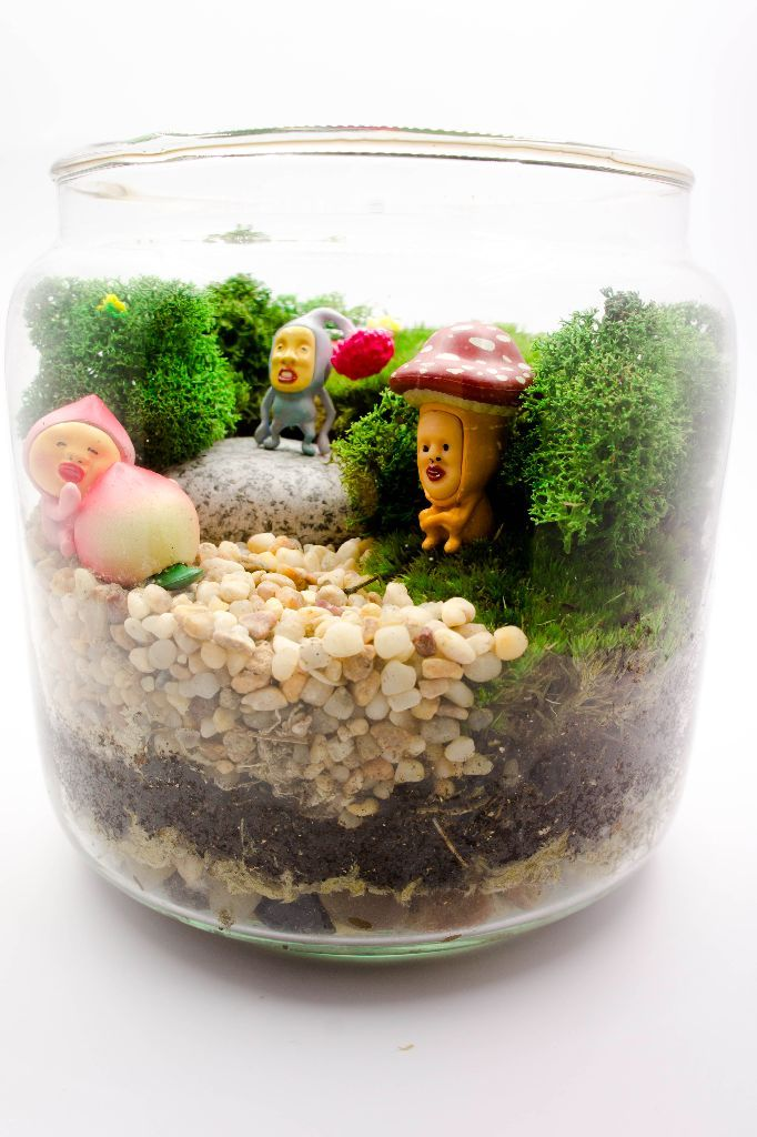 "Kobito Dukan Terrarium Kobito Dukan characters are perhaps the best example to illustrate the term ""Kimokawaii"", meaning something first comes as grotesque but turns endearingly cute afterwards. They are magical little creatures dwelling in jungles. The Terrarium features three of them quietly enjoying a moment of peace in woods."