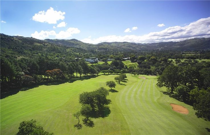 Aerial view of golf course with clubhouse in the background