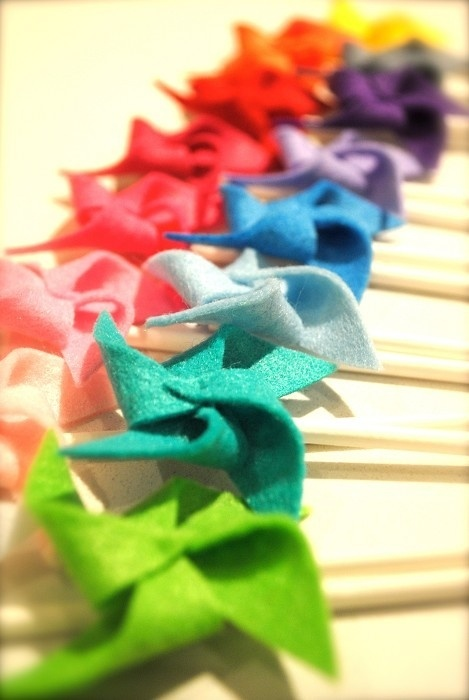 Pinwheel felt cake toppers. Make 'em a bit bigger and use buttons in the centre? by callie