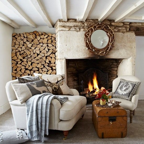 Cream country living room. Make a classic country scheme feel informal with lots of natural texture, including cosy woollen blankets. Woodland themed cushions will add a cheerful feel that will appeal to adults and kids alike. Similar mirror, Clock House Furniture, Similar sofa George Smith.