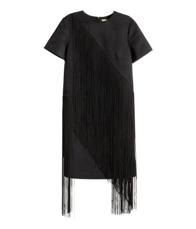 Short dress in woven fabric with short sleeves, long decorative fringe at front and back, and a concealed back zip. Unlined.