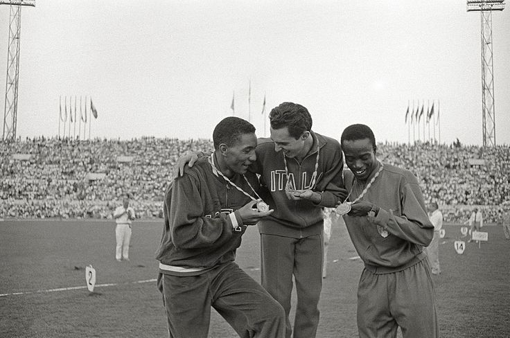 Medal winners from different countries: Lester Carney, Livio Berruti, Abdoulaye Seye 1960