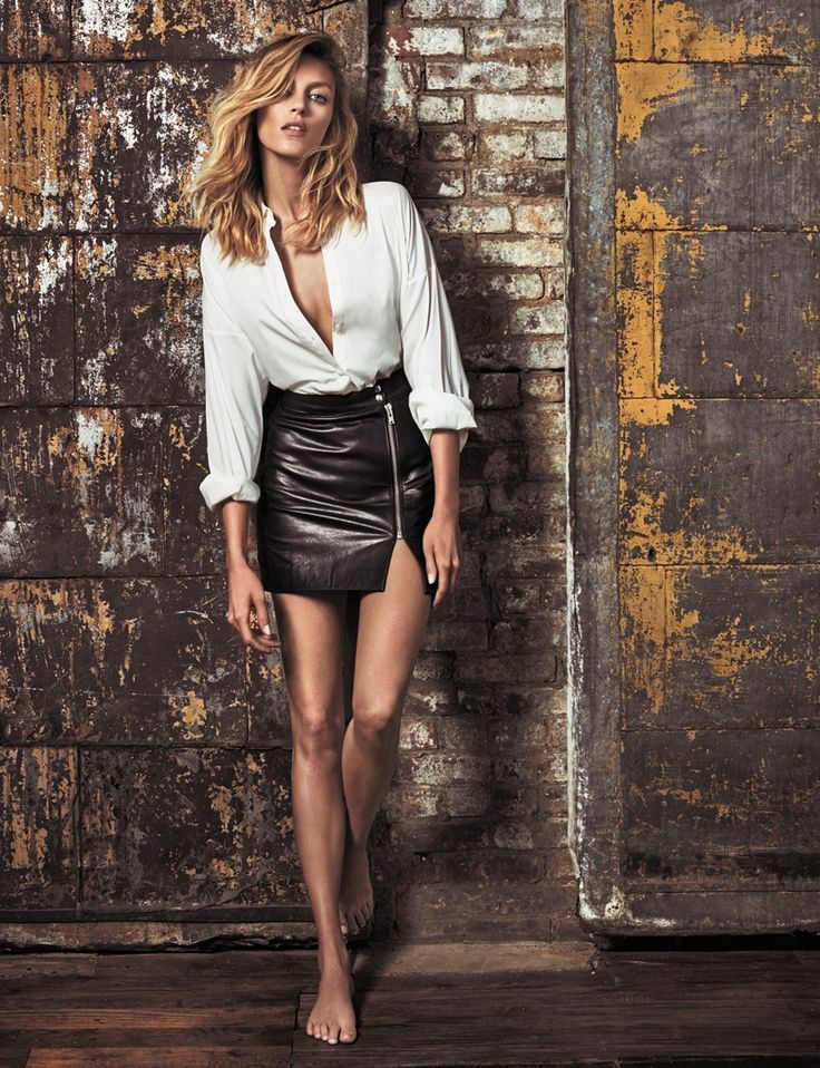 Anja Rubik flaunts some serious leg in an Anja Rubik x Iro top with leather mini skirt