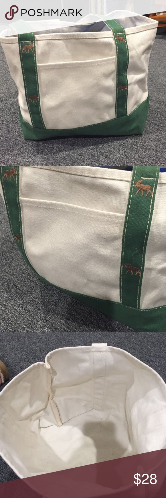 Canvas Tote Very gently used canvas tote bag. Green straps with embroidered moose, one exterior  slip pocket. Very little signs of use. Are you think this is from Abercrombie but not 100% sure. Abercrombie & Fitch Bags Totes