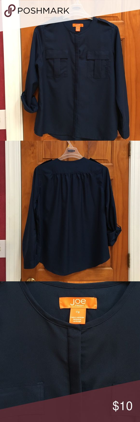 Joe Fresh basic Navy Blue long sl blouse LARGE Joe Fresh misses size Large navy blue blouse.  See pictures - sleeve roll up button tabs or buttoned cuffs.  Placket pockets on front with hidden buttons down front.  Collarless with shoulder button placket. Joe Fresh Tops Blouses