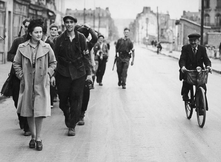 A French woman accused of collaboration, or consorting with Germans, is marched through the streets of Elbeuf, north-west of Paris, by Resistance members, circa 1944.
