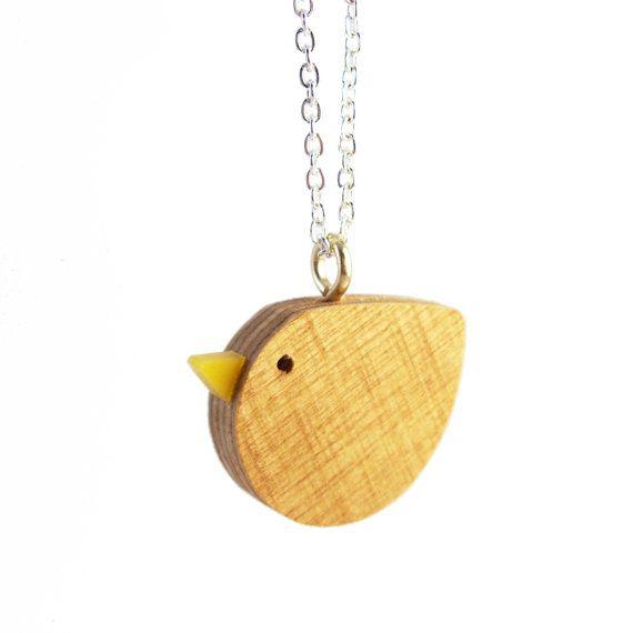 Wooden Bird Necklace by iamacrylic at etsy.com (This wooden bird necklace is hand cut from 6mm plywood with a tiny yellow acrylic beak.)