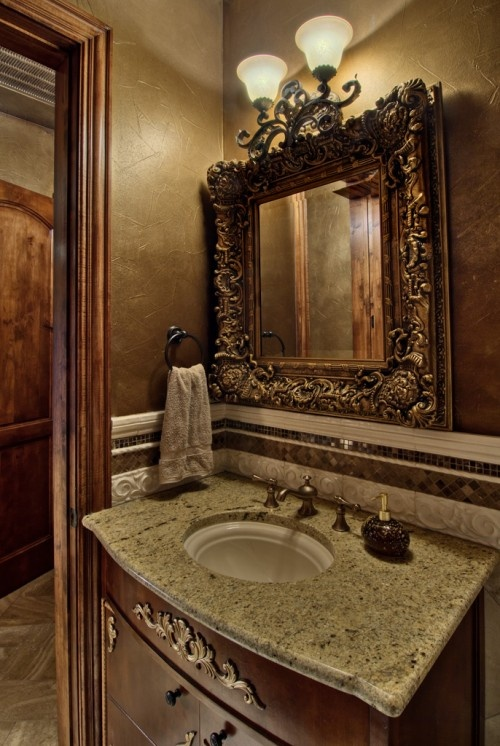 An Ornate Mirror And Muted Tones Of Brown Cream Give This Powder Room Elegant Traditional Feel Decorating Ideas Pinterest