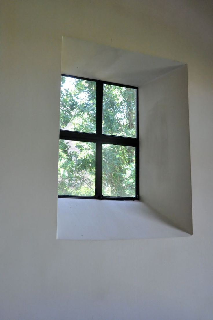 [Front Stairs]  Window in stairway from plaster wall