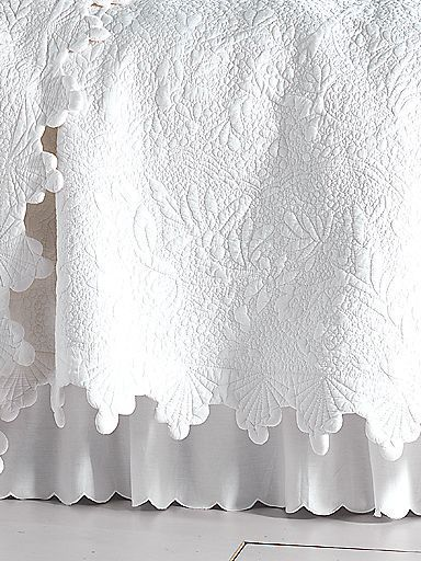 Give your bed a spring makeover with a white coverlet and bed skirt
