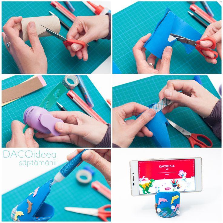 DACOideea săptămânii - Suport pentru telefon. Materiale: Hârtie Gumată autoadezivă, tub carton, Lipește-mă drăguț, Perla, Perforator Hobby, Lipici glitter neon, liniar, Silipici, pix, Foarfecă grădiniță, Planșetă tăiere A3. TUTORIAL VIDEO: https://youtu.be/hr_GbnfV8ug. Magazin online: http://www.dacomag.ro.