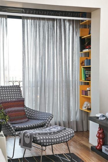 armchair + yellow bookcase