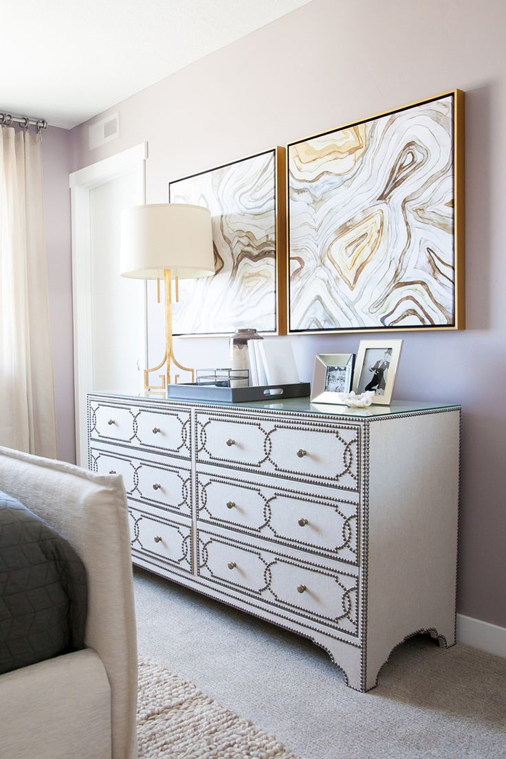 An agate print will stand out beautifully when you use a golden frame, especially when there's a touch of gold in the print itself. Oh, and don't forget to put a golden mid-century lamp on your dresser. It will complete the look.
