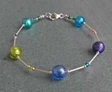 Murano glass bracelet by Firefrost . We love this lovely little multi coloured glass and silver bracelet. Goes well with our small Carina earrings.