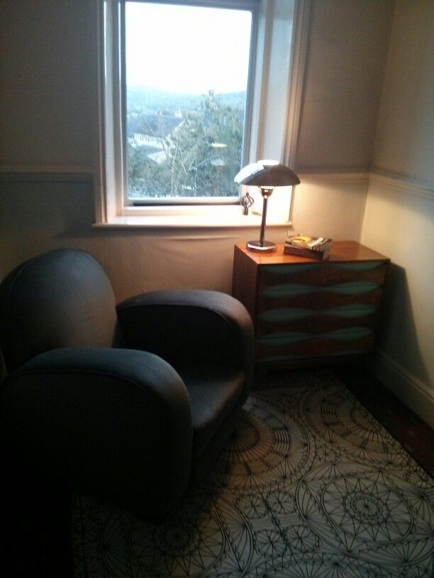 Reading area on the landing, and a place from which to admire the view of West Yorkshire. Rug from IKEA, chest of drawers from Oliver Bonas, lamp is many years old IKEA and chair is one of a (1930s?) pair from a Malton antiques dealer.